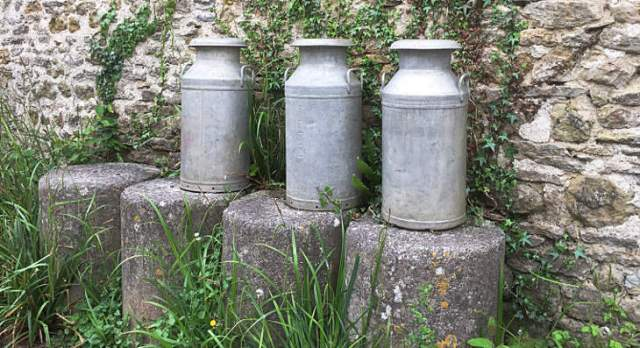 milk churns on display